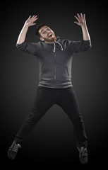 Full Length Shot of Young Man in Wacky Pose