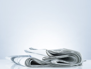 Folded newspaper.On blank desk.