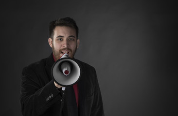 Man in Black Suit Speaking Using Megaphone