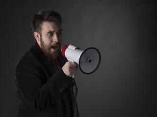 Talking Young Man Using Megaphone