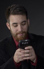 Close up Goatee Businessman with Phone