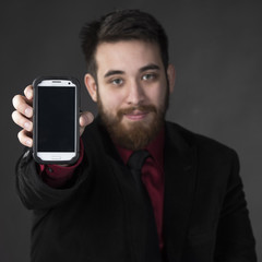 Young Businessman Showing his Smart Phone