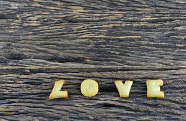 Love cookies alphabet on wooden background