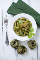 Tagliatelle with pesto sauce, view from above, studio shot