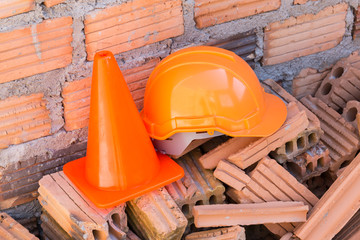 construction helmet safety and cone in construction site