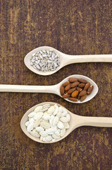 wooden spoons with different kinds of seeds and nuts