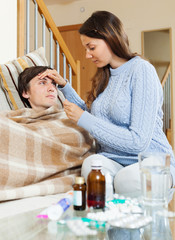 woman caring for sick guy who high temperature