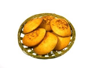 Golden yellow baked Dutch egg cakes over white