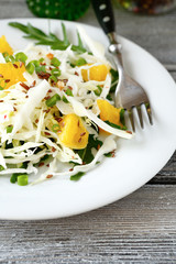 Fresh salad with cabbage and orange