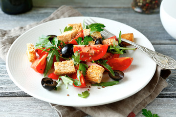 Fresh salad with tomatoes and croutons on a plate