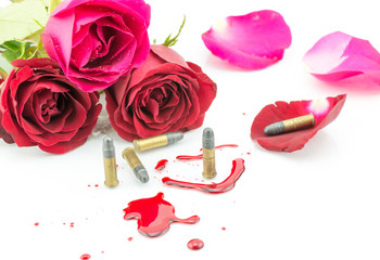 bullet on blood and red rose isolated on white background