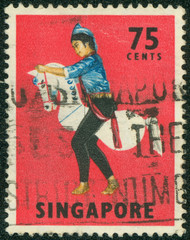 image of a traditional Kuda Kepang dancer on a horse prop