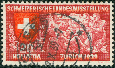 stamp printed in Switzerland shows coat of arms of confederation