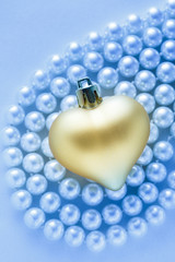 Heart on white pearl necklace