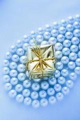 Present box on white pearl