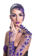young woman with beautiful hair style and art purple make-up