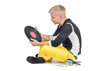 Guy with headphones and vinyl