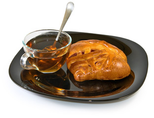 Isolated image of a cup of tea and a bun