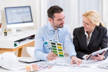Engineer and architect working at the office