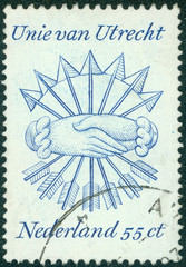stamp of the Union of Utrecht with shaking hands and arrows
