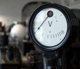 Vintage voltmeter. Part of old power plant.