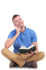 young man reads and daydreams