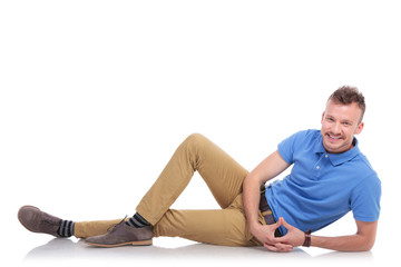 happy young man lying on the floor