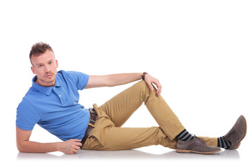 young man lying on the floor