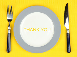 Plate with text Thank You, fork and knife