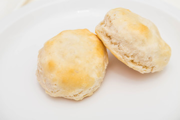 Two Fresh Biscuits on White Plate