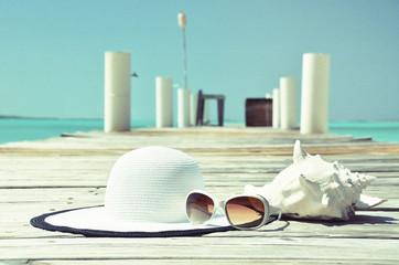 Hat and sunglasses on the wooden jetty. Exuma, Bahamas