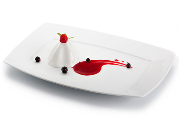 Jelly dessert with berries on white plate