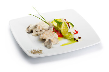 Plate with chicken and mushrooms stew with vegetables