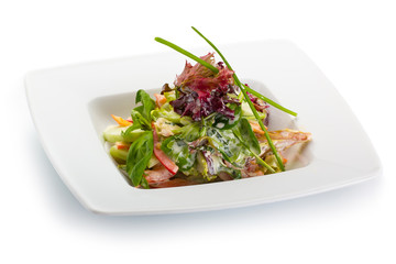 Spring salad with fresh vegetables in a white plate