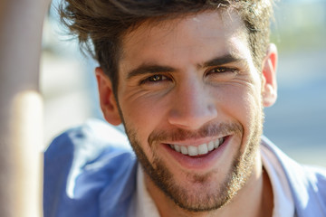 Portrait of attractive guy smiling