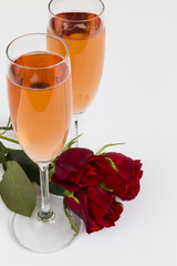 Rosé champagne flutes with roses