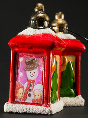 red christmas lanterns with snowman and children decoration