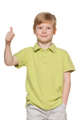 Handsome young boy shows his thumb up