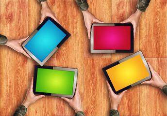 Hands Holding Digital Tablet Computers