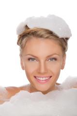 beautiful young woman in soapy foam