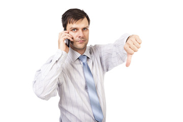 Portrait of disappointed young business man showing thumb down s