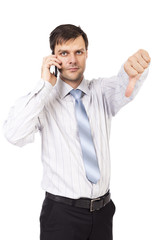 Disappointed young business man showing thumb down sign while sp