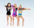 Three cheerful girl gymnasts.