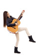 Full length portrait of happy teenage girl playing guitar