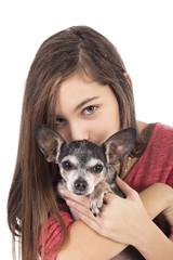 Closeup of teenage girl holding a cute chihuahua dog
