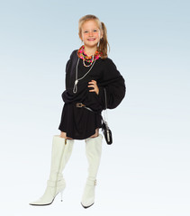 Little girl in a black short dress and high white boots.