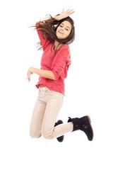 Beautiful teenage girl jumping