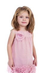 Portrait of an adorable little girl with pink dress standing