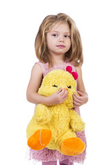 Portrait of an adorable little girl holding a yellow plush toy