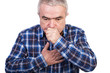 Senior man coughing and accusing chest pain